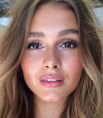 natural and glowing skin bold brows blushed cheeks and soft lips makeup inspiration