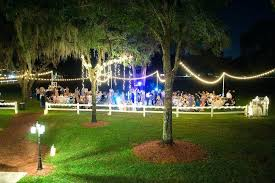 wedding venues in brandon fl outdoor wedding reception under moss covered oak tree with le lights