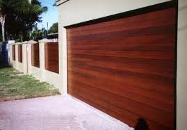 matching gate and fence panels with a rich gloss stain