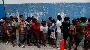 Hundreds greet Aristide on return to ...