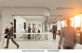 wide angle view busy design office. rear view of three people communicating in glass meeting room busy office 3d rendering wide angle design