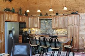 rustic kitchen island table. Magnificent Four Pendant Island Lamps Over Rustic Kitchen Also Oak Unfinished Cabinets Added Vintage Furniture Open Designs Table