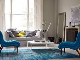light blue living room furniture. blue themed living room ideas with rug on the white floor and light grey fabric furniture g