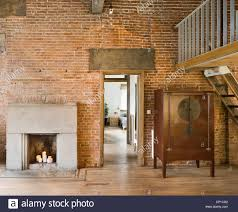conversion of old brick wall building into a modern house in stock photo royalty free