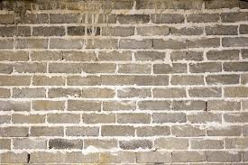 old brick wall background texture and pattern with grunge mortar between exterior face bricks in an