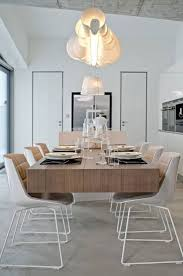 Modern Light Fixtures in Dining Room with Long Oak Table and White