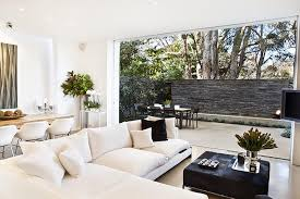 outdoor living room design. white living room with sectional couch and outdoor patio design