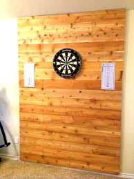 cork board dart backboard with accent wall for the game room dartboard bracket argos