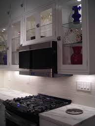 lighting for cabinets. picture of glass front kitchen cabinets with decorative puck lights inside lighting for o
