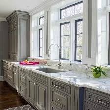 Gray KItchen Cabinets with Marble Window Sills