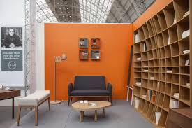 lots of wall shelving is a hallmark of a family or living room the storage casual living room lots