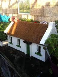irish thatched cottage garden ornament