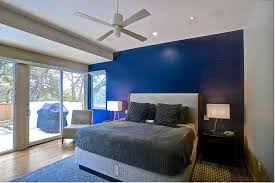 Modern Bedroom Features Dark Blue Accent Wall A Bold Blue Accent Wall