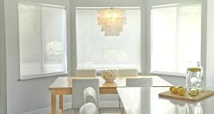 chic kitchen with gray walls paint color bay windows rectangular wood table west elm chandelier white modern chairs and yellow accents capiz instructions