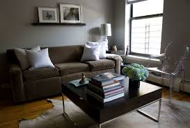 grey wall theme and white cushions on brown fabric sofa added by ...