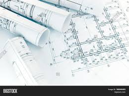 architecture blueprints. Rolls Of Architecture Blueprints With Floor Plan Drawing On Architects Workspace