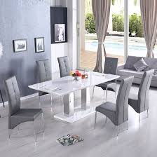 monton modern extendable dining table in white high gloss with 6 vesta dining chairs in grey faux leather finish white high gloss features monton modern