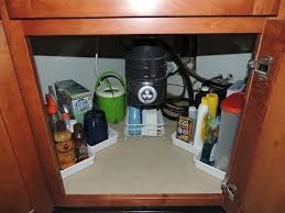 how to organize your under sink space with storage trays