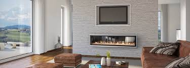 escea dx1500 multiroom gas fireplace in a brick wall adds lots of value to this new