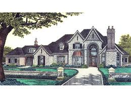 luxurious two story european home with stone façade