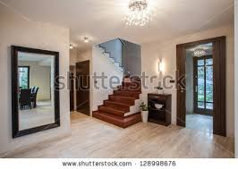 Travertine house: entrance and hallway, modern interior