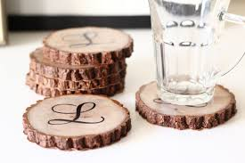 monogrammed personalized waterproof wood slice coasters perfect for a wedding or bridal shower gift i love the look of black ink on wood