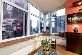 built in seating area around window facing times square contemporary living room