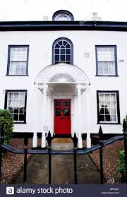 stylish old white house with red door in Ongar Essex UK Stock ...