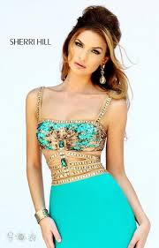 prom 2016 sherri hill turquoise gown with egyptian look on bodice