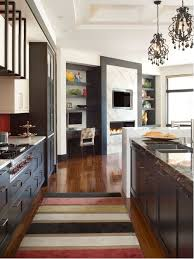 example of a trendy open concept kitchen design in denver with shaker cabinets and dark wood