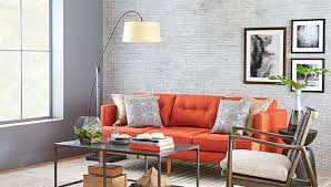 living room paint color scheme with gray wall whitewashed gray faux brick and orange sofa