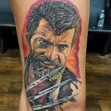 фото татуировки росомахи в стиле марвел на бедре парня фото