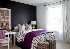 View in gallery Plush purple accents in the black and white bedroom