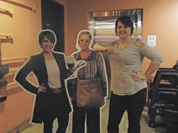 rockwall painting with a twist pwat artist bree ann mccleskey poses with pwat co founder renee maloney s cutout posters at the undercover boss watch