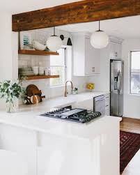 white small kitchen color concept with ball chandelierinimalist wooden wall mounted shelves