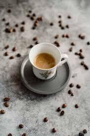 Cup of espresso and scattered coffee beans - AFVF02355 - VITTA  GALLERY/Westend61