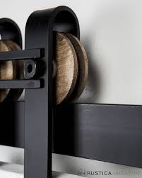 horseshoe with bar barn door rollers by rustica hardware