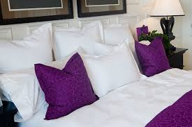 pillow shams and throw pillows set up on bed