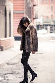 raquel paiva looks striking in this fluffy coat outfit consisting of a large faux fur