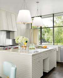 a cur trend in lighting design are large kitchen pendants over an island
