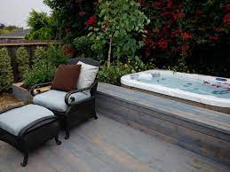 traditional wood deck with hot tub and