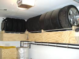 garage tire rack i found a picture of the storage i describe above garage wall mounted garage tire rack wall mount