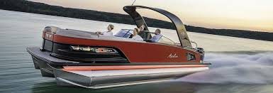 high performance 2018 avalon luxury pontoon boat sding through water with bow lift