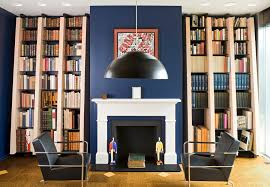 glamorous mantel shelves in living room contemporary with built in bookshelves next to backsplash alongside decorating a blue couch and fireplace