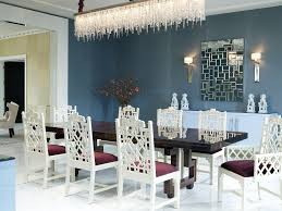charming glass rectangle chandelier over black white dining table set as well as white wooden carving dining chairs as decorate in vintage blue dining room