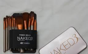 first e first talking about its packaging the brushes e in a tin box with 3 urban decay written on it