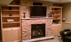 harvest profit ledgestone custom cabinets gas fireplace