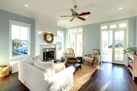 recessed lighting with ceiling fan fans lights for living room this rooms pale palette is warmed
