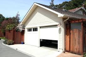 roll up garage doors one of two white roll up garage doors on a small paneled roll up garage doors