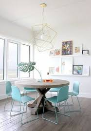 light and fresh dining area with pretty turquoise chairs 24 fashionable geometric décor ideas for your dining e digsdigs